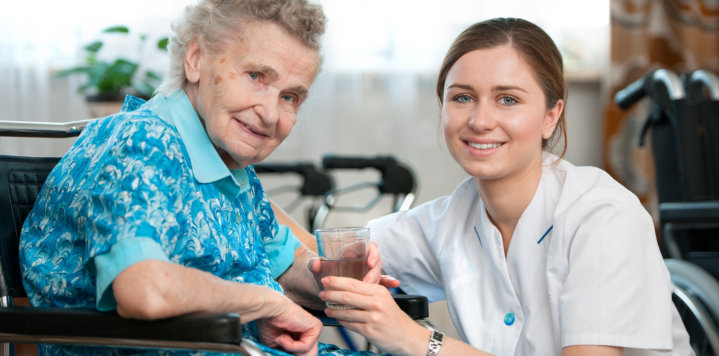 elderly woman and a caregiver
