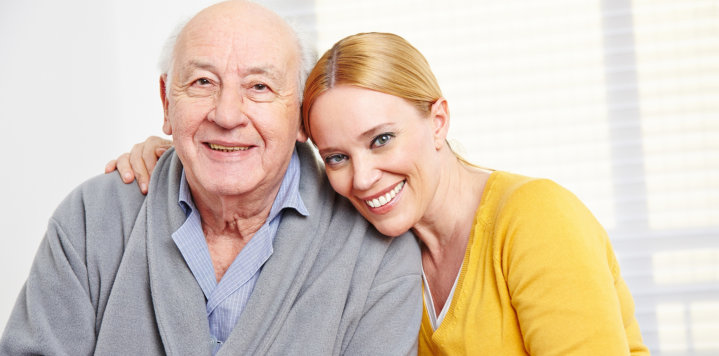 elderly man and a woman smiling